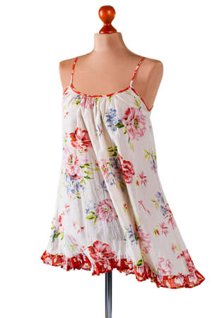 woman's clothing: Casual floral pattern sarafan. Vintage sarafan on armless mannequin. Womans light summer clothing. Garment of lightweight material.