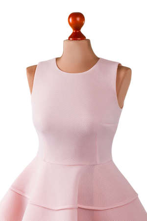 Sleeveless salmon evening dress. Salmon dress on beige mannequin. Simplicity and charm. Girls clothing for prom.