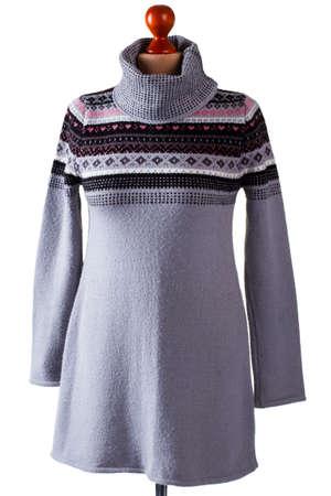 pullover: Gray sweater with high collar. Gray pullover on headless mannequin. Ladys woolen garment in studio. Warm handmade sweatshirt on sale.
