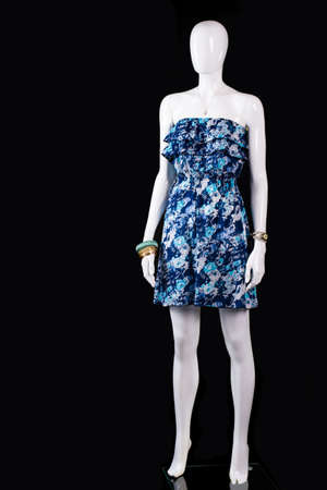 summer dress: Short blue summer dress. Mannequin wearing short floral dress. Trendy dress on black background. Womans brand new summer clothing. Stock Photo
