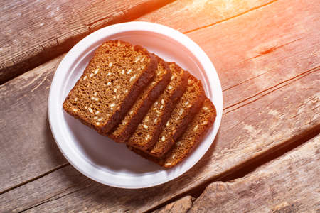 savoury: Sliced bread on a plate. Slices of brown grain bread. Recipe of homemade bread. Healthy savoury food.