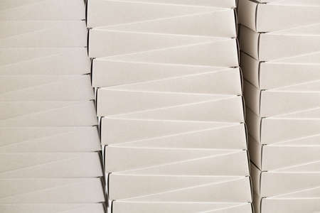 boxes stack: Plain white boxes. Stack of white carton boxes. Inexpensive food containers in warehouse. Free delivery of cheap merchandise.