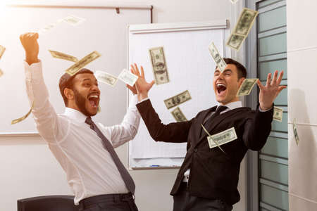 Businessmen rejoice of profits. Successful managers scatter dollars.