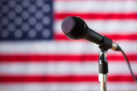 told: Microphone on US flag background. Banner and microphone with wire. Truth will soon be told. Broadcast for american citizens.