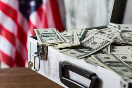 chances: Pile of dollars in suitcase. USA flag, cash and case. More chances for victory. Compliment from local executive.