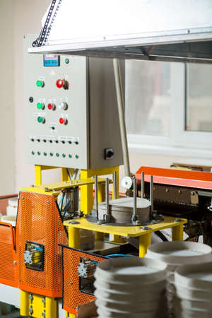 cake factory: Factory machine with control panel. Industrial equipment beside window. Device for cake packaging. Complex algorithm of work.