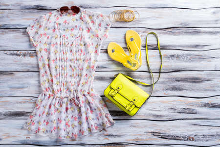 low blouse: Blouse, flip flops and purse. Light blouse and lime bag. Womans outfit with bright accessory. Summer apparel at low price.