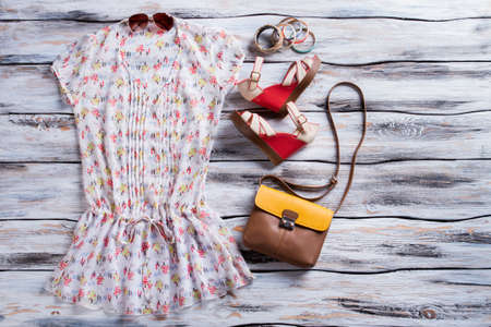 wedge: V-neck blouse and wedge sandals. Red wedge shoes with bag. Girls comfortable summer outfit. Special prices in boutique.