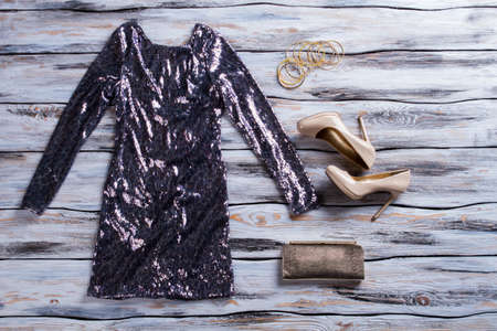 sparkly: Gray sparkly dress and shoes. Beige glossy heels and dress. Ladys luxury evening outfit. Stylish apparel sold at boutique.