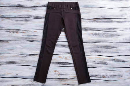 Black skinny fit trousers. Dark-colored female pants. Pants of cotton and stretch. Clothing made of synthetic material. Stock Photo