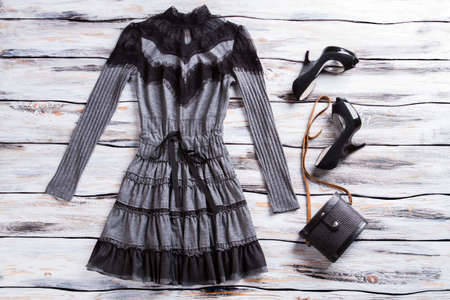 cotton dress: Gray dress with long sleeves. Black heels and gray dress. Cotton dress with black inserts. Merchandise from top seller.