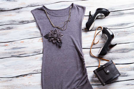 applique flower: Gray evening top with necklace. Flower applique top and heels. Girls trendy evening outfit. Looking good is an art.