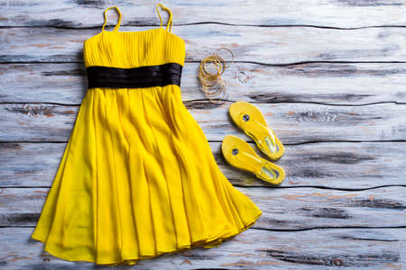 flip flops: Yellow dress and flip flops.