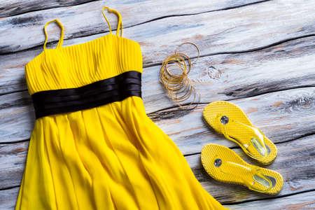 footwear: Yellow dress, footwear and bracelets.