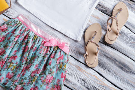 pink bow: Floral skirt with pink bow.
