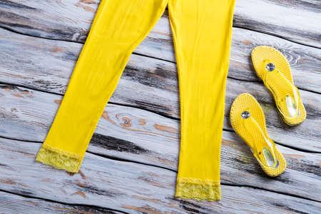 flops: Yellow flips flops and pants.