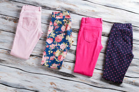 cotton flower: Pink and dark navy pants on wooden background. Stock Photo