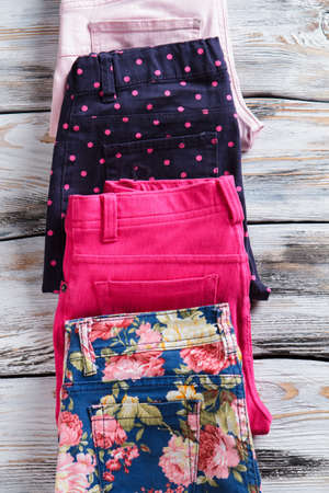 limited time: Blue casual pants with print. Navy and pink folded trousers. Limited time offer with discounts. Authentic goods of high quality.