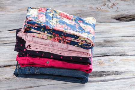 trousers: Stack of folded trousers. Stock Photo