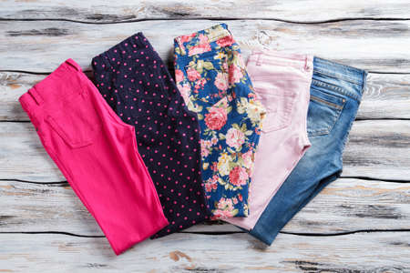 Jeans and trousers with colorful print.