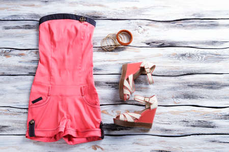 wedge: Jumpsuit shorts and wedge sandals.