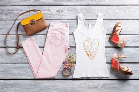 wedge: Light pants with white top. Bicolor purse and wedge sandals.