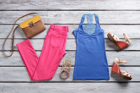 bicolor: Blue top and pink pants. Bicolor purse and wedge sandals.