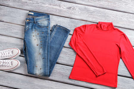 pullover: Red top and blue jeans. Stock Photo