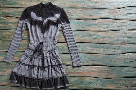 long sleeves: Dark dress with long sleeves.