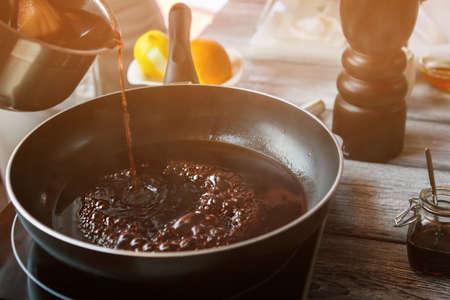 boiling: Dark liquid boiling on pan.