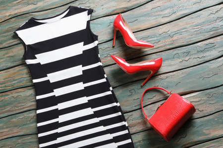 sleeveless dress: Black and white evening dress. Glossy heels and sleeveless dress. Ladys new leather purse. New merchandise on auction.