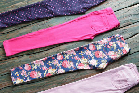 saturated color: Blue and light pink trousers. Womans casual pants with print. Saturated color and stylish pattern. Check out the new merchandise.