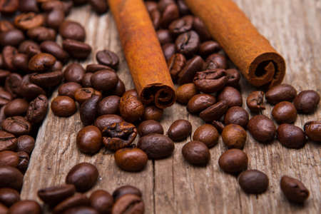 robusta: Coffee beans and cinnamon stick. Brown coffee grains and cinnamon. Spice for beverages. Aroma of robusta.