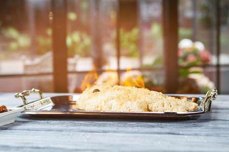 breading: Burning fish on tray. Whole breaded fish. Secret recipe for dorado fish. Breading made of sea salt.