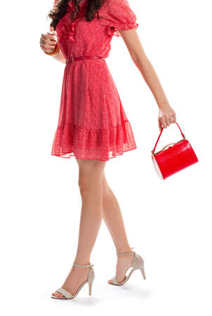 summer dress: Woman in summer dress. Young girl on heels. Casual dress with short sleeves. Shopping went well. Stock Photo