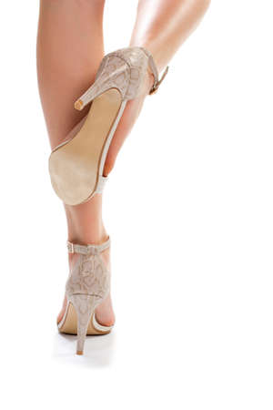 femininity: Legs in heel shoes. Womans footwear on white background. Luxury shoes from outlet shop. Charm and femininity.