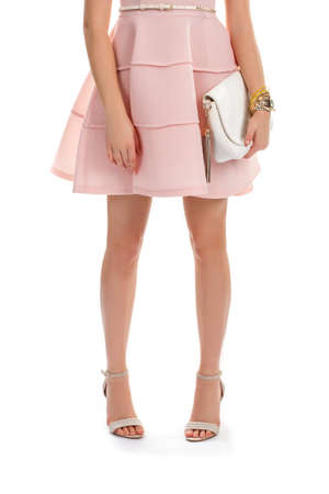 cotton dress: Woman wears salmon dress. Beige heels and white handbag. Stylish accessories from new collection. Cotton dress with folds.