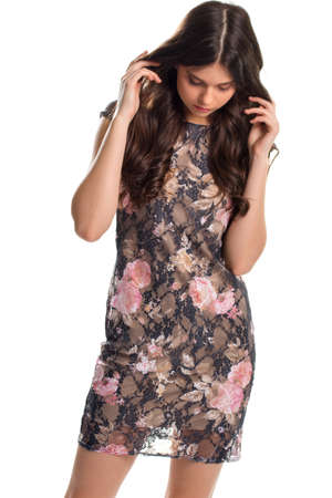 lining: Woman in short dark dress. Dress with pink floral print. Trendy dress from famous brand. Soft lining made of silk.