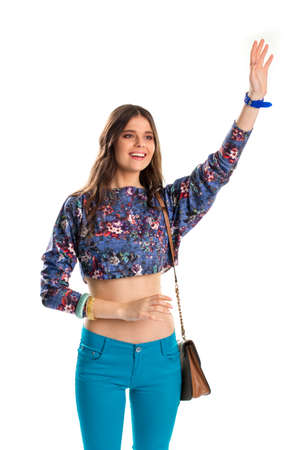 Young girl waves her hand. Woman in crop top smiling. Meeting old friends. Happy model in casual outfit.