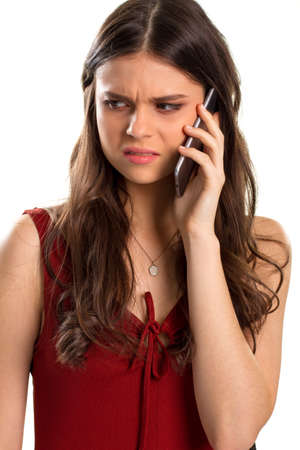 bad mood: Young woman holds a phone. Ladys face showing disgust. Worst conversation ever. Bad mood for whole day.