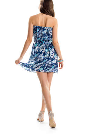 strapless dress: Woman in blue strapless dress. Back view of young lady. Stylish design of summer garment. Slim model wears heel shoes. Stock Photo