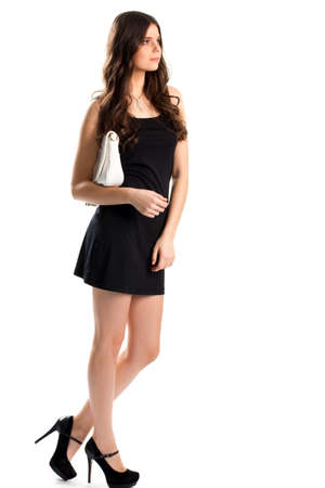 cotton dress: Girl in sleeveless black dress. Necklace and high heels. Suede footwear from new collection. Cotton dress with u-neck.