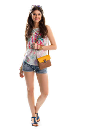 sleeveless top: Lady in tank top smiling. Short shorts and sleeveless top. Printed clothes and stylish accessories. Nice outfit for warm season.