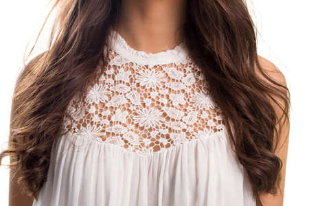 sleeveless top: Woman in white top. Sleeveless top with lace insert. Light and stylish garment. Natural fabric of high quality.