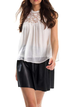Young woman in white blouse. Lady in black skirt walking. New apparel from boutique. Clothes of top quality materials.