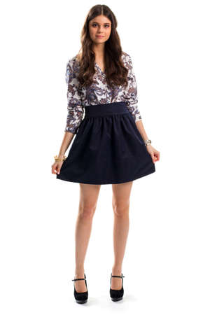 black heels: Lady in floral shirt. Navy skirt and black heels. Cute model wears fashionable clothes. Spring evening outfit. Stock Photo