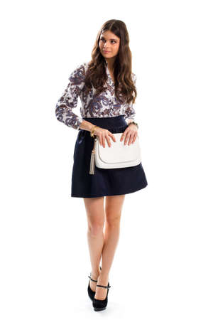 outlet store: Woman in floral shirt. Dark navy skirt and heels. New apparel from outlet store. Leather handbag and expensive bracelets. Stock Photo