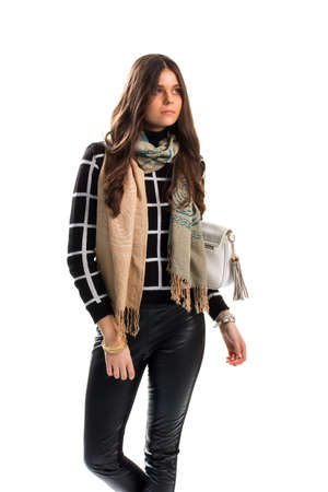 checkered scarf: Lady wears beige scarf. Black and white checkered pullover. Trend of this autumn. Stylish scarf with print.