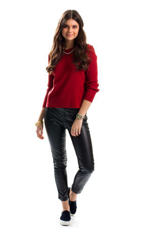 Woman in red sweater smiling. Necklace, bracelets and watch. Slip on shoes from boutique. Nice fashionable outfit.