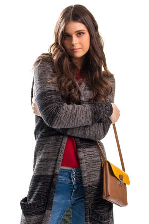 outerwear: Woman in outerwear. Striped sweater coat with pockets. Casual outfit and stylish handbag. Quality wool and cotton.